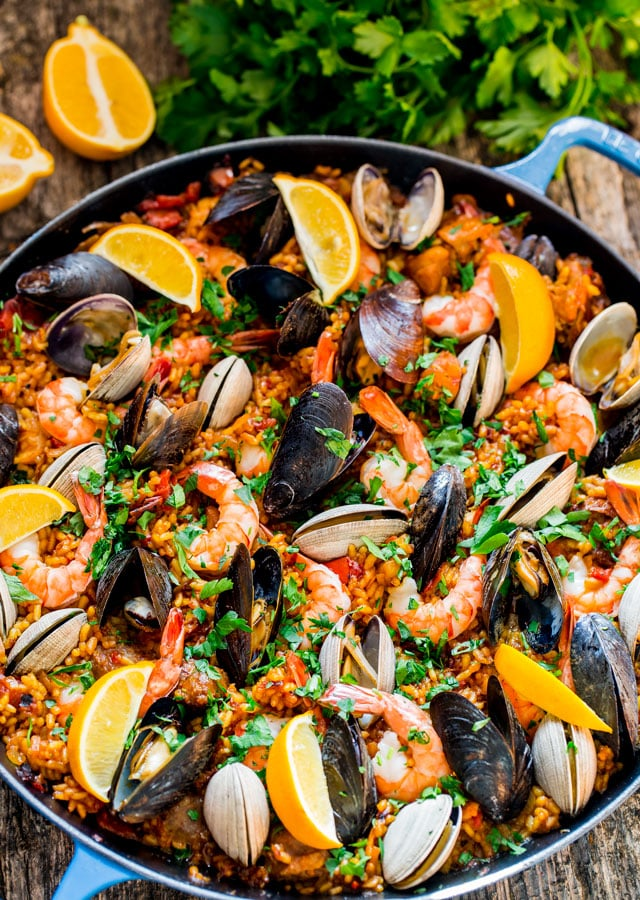 overhead of a paella pan filled with Chicken and Seafood Paella