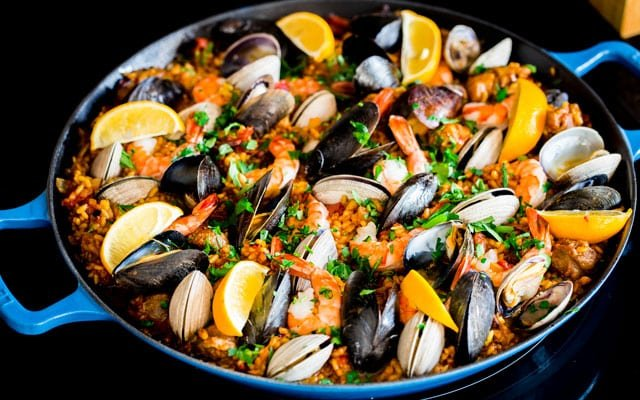 Chicken and Seafood Paella in a blue paella pan