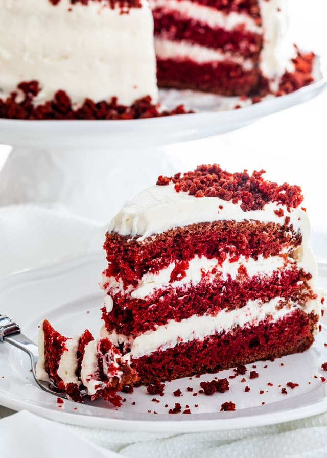 slice of red velvet cake on a white plate
