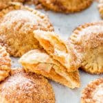 churro apple pie cookies with one split in half exposing the center