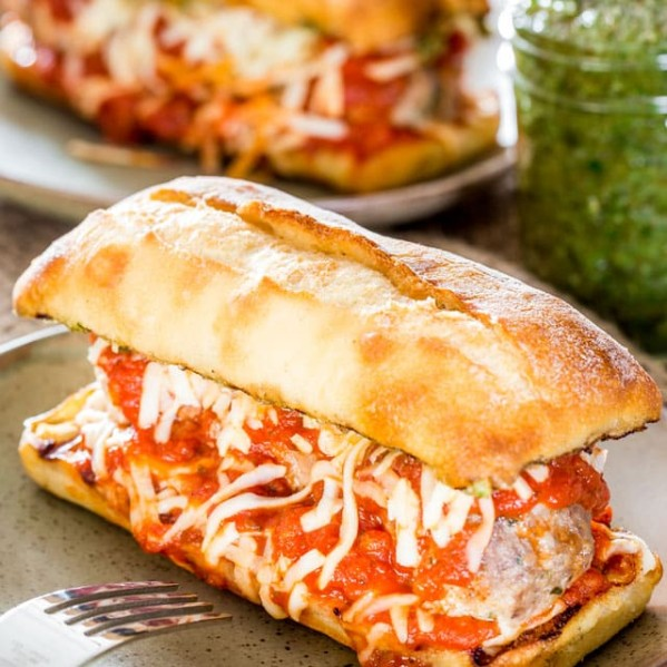 side view shot of a meatball sub on a plate