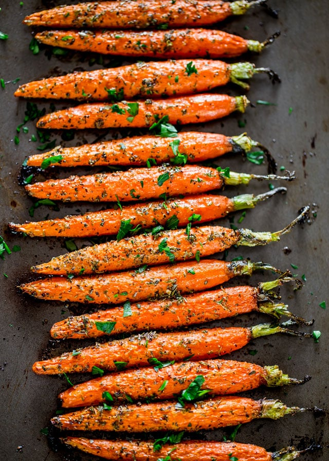 Garlic and Herb Roasted Carrots fresh out of the oven on a baking sheet