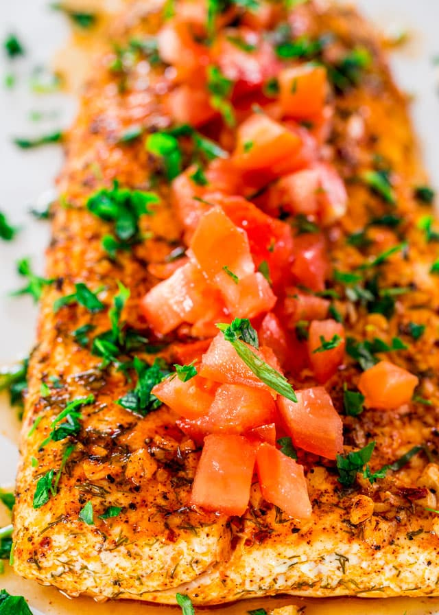 lemon garlic halibut topped with chopped tomatoes and parsley