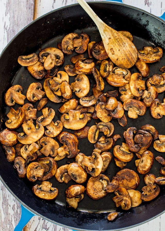 overhead of a skillet of sauteed mushrooms for couscous pilaf