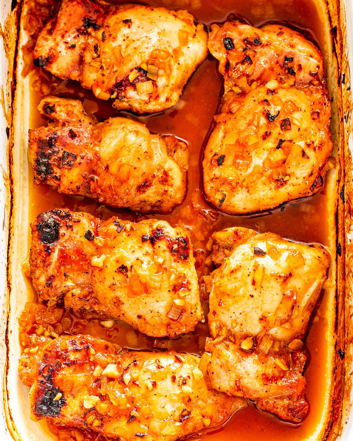 Spicy Honey Garlic Chicken Thighs in a casserole dish right out of the oven