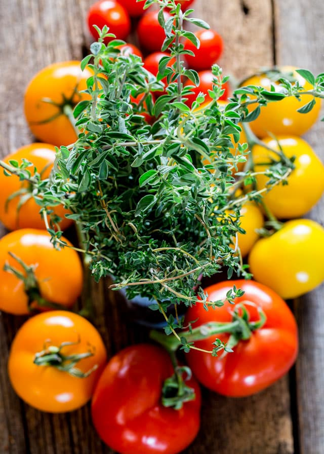 fresh thyme and heirloom tomatoes for Summer Salad with Herbed Ricotta