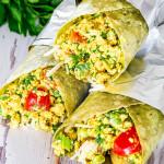 3 vegan breakfast burritos wrapped in foil