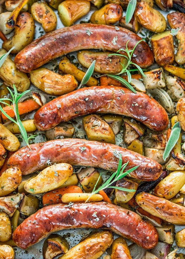 Baked Sausages with Apples right out of the oven garnished with fresh rosemary