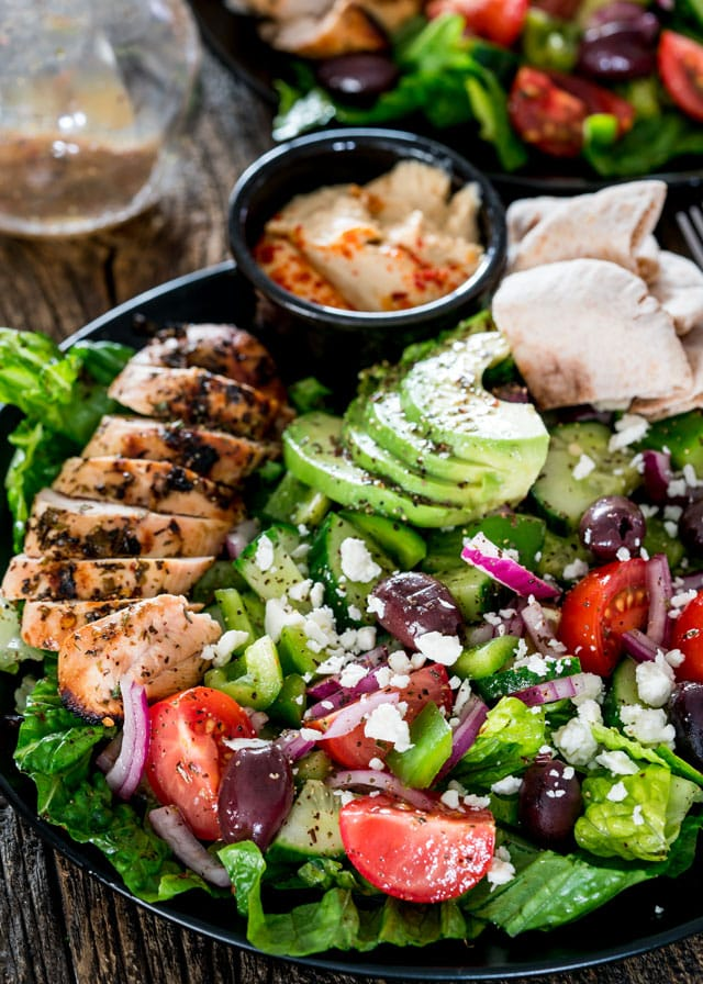 a plate of Mediterranean Grilled Chicken Salad with hummus