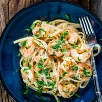 overhead shot of italian shrimp with pasta on a plate