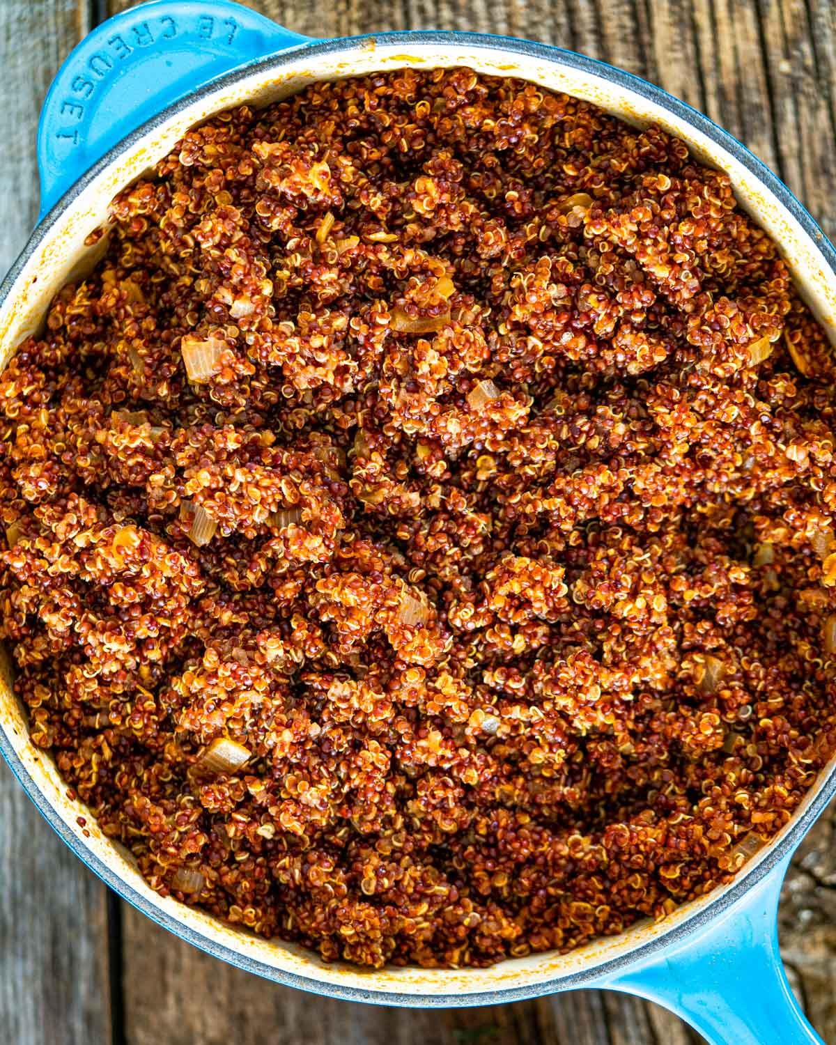 cooked red quinoa in a blue Dutch oven