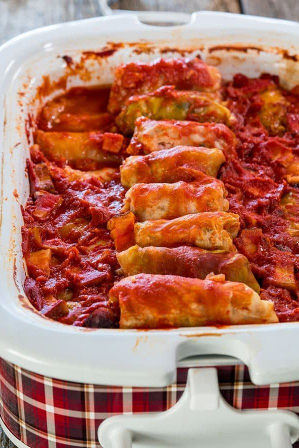 side view shot of cabbage rolls in a crockpot