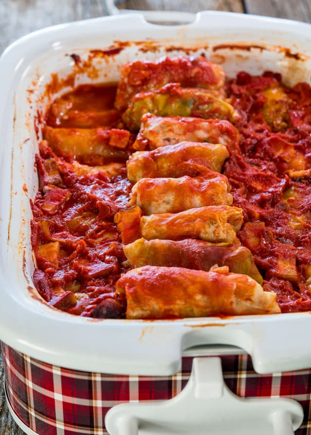 Crockpot Cabbage Rolls - try my traditional cabbage rolls with ground pork, rolled in sour cabbage leaves and slowly cooked in a crockpot. So simple and a definitely a favorite!