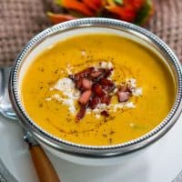 side view shot of a bowl full of curried butternut squash soup