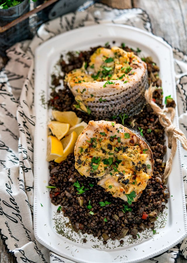 Blue Pointe Stuffed Striped Sea Bass - these delicious fillets of striped sea bass are stuffed with Lump Blue Crab Meat then served on a bed of delicious Beluga lentils.