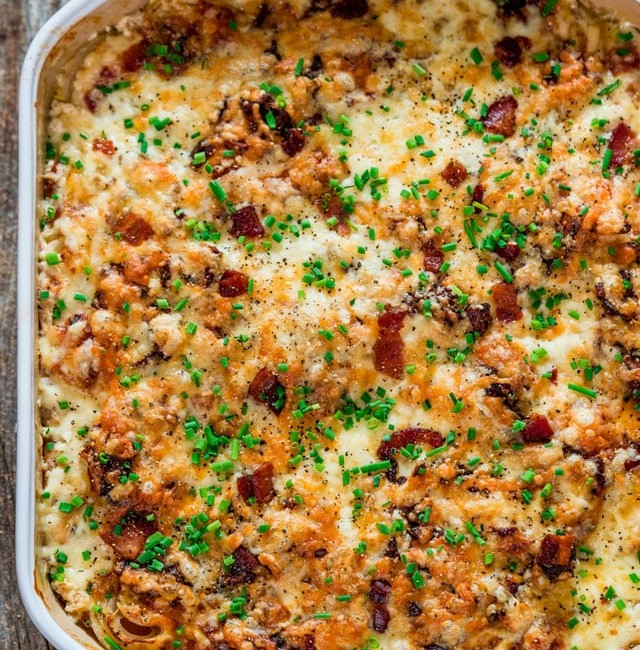 overhead shot of scalloped sweet potatoes in a baking dish