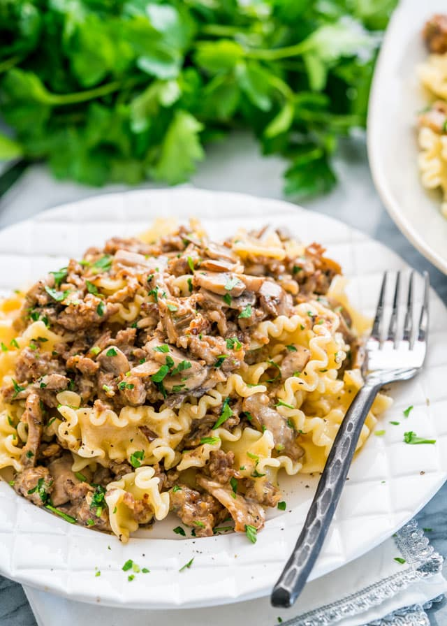 This Creamy Sausage Mushroom Pasta is pure comfort food. A rich and creamy sauce loaded with Italian sausage and mushrooms served over the pasta of your choice, total crowd pleaser!