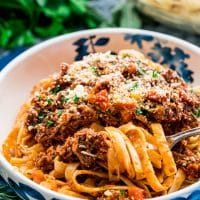 side view shot of a bowl of braised beef ragu fettuccine