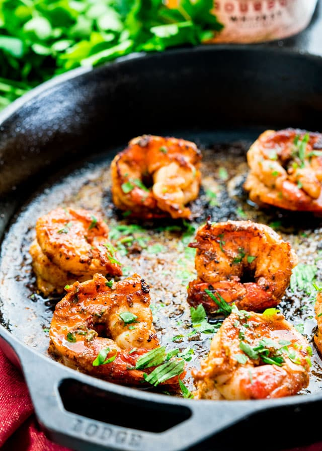 perfectly seared prawns in a skilled topped with parsley