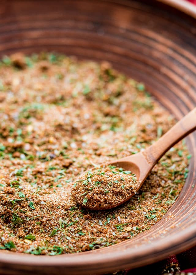 jerk seasoning blend in a bowl with a small wooden spoon