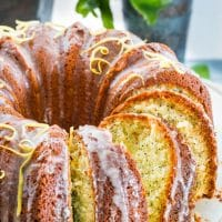 side view shot of a sliced lemon poppyseed bundt cake
