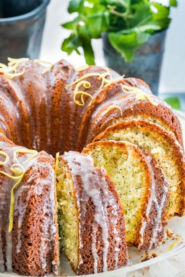 side view shot of a sliced lemon poppyseed bundt cake