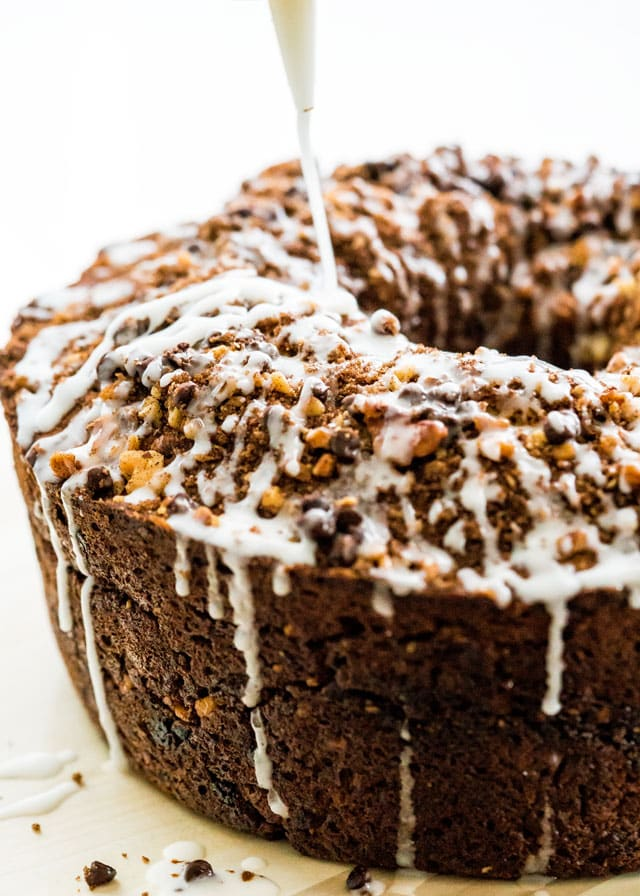 This Banana Chocolate Chip Coffee Cake is a tasty new take on your regular banana bread. Loaded with walnuts and chocolate chips and a brown sugar cinnamon filling, this coffee cake won't let you down!