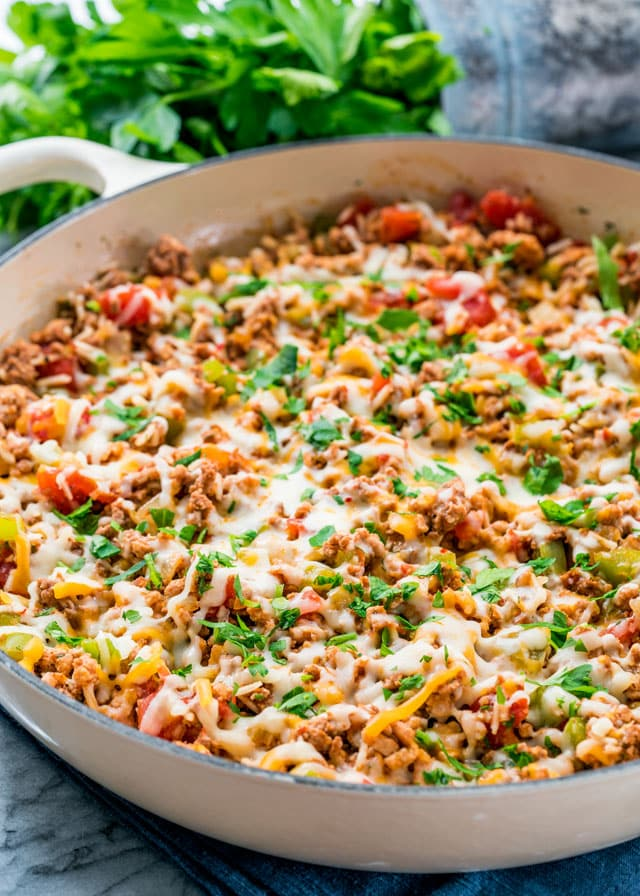 This deconstructed stuffed pepper casserole offers you all the great flavors of stuffed peppers, but it can be ready in a fraction of the usual amount of time. This casserole really does taste like real stuffed peppers but ready in 30 minutes, perfect for any busy weeknight!