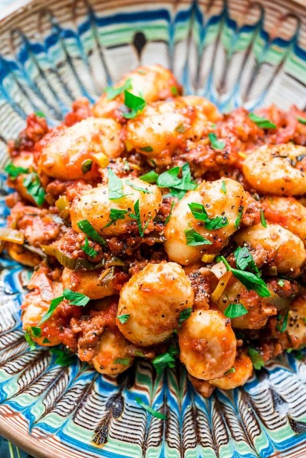 top shot of sausage leek ragu gnocchi on a plate