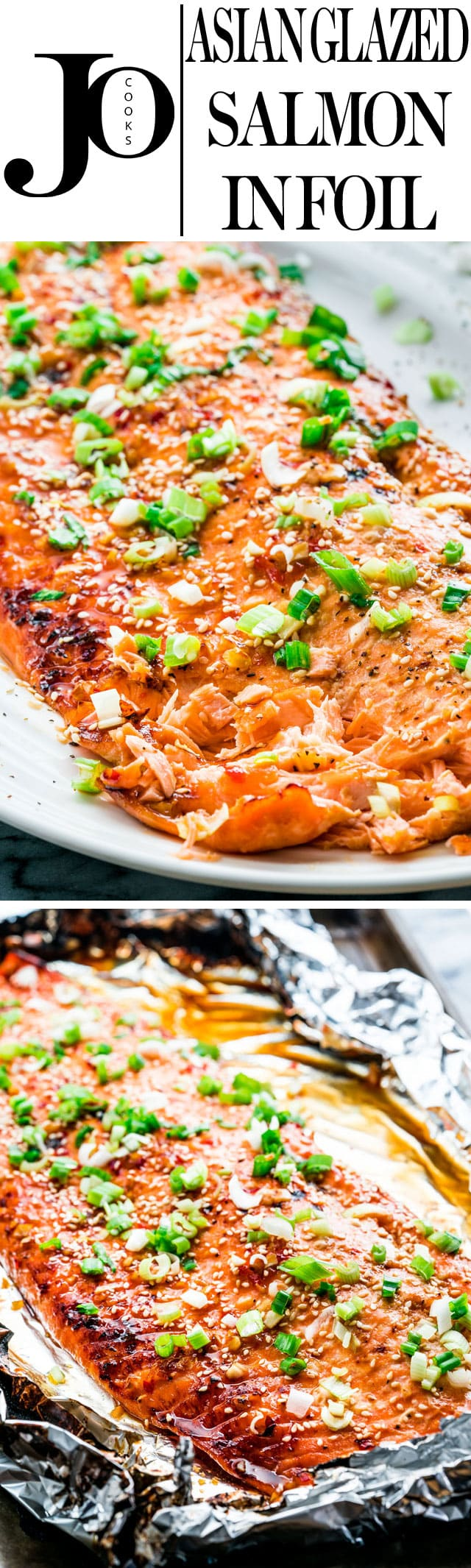 This Asian Glazed Salmon in Foil is probably the easiest way to make fish. This salmon bakes in 25 minutes, it's juicy and loaded with flavor, not to mention it's really healthy and good for you! www.jocooks.com #salmon