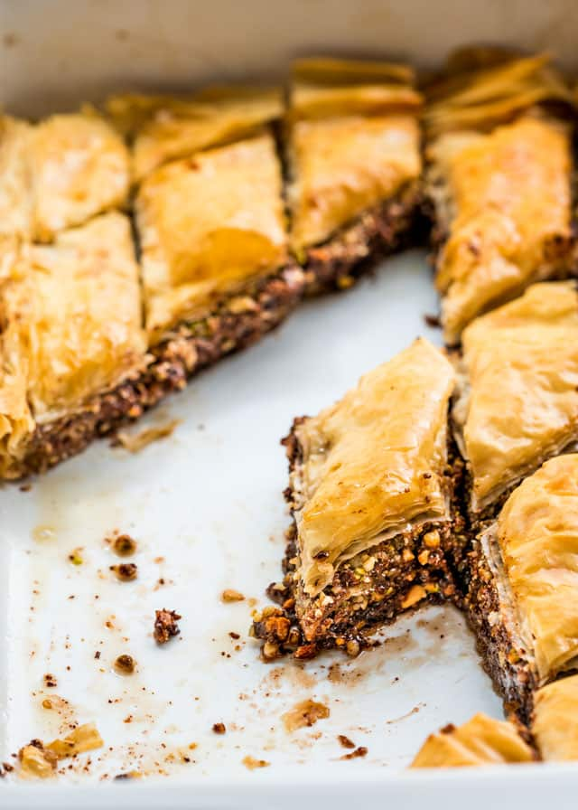 a pan of chocolate baklava with a few pieces taken out