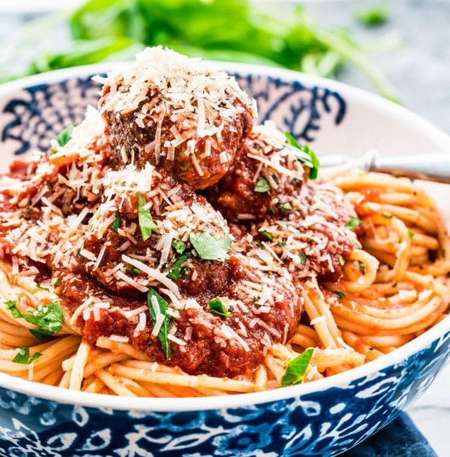 side view shot of a bowl of spaghetti and meatballs