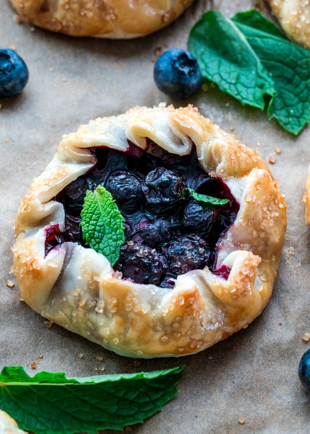overhead of a blueberry galette with fresh mint leaves