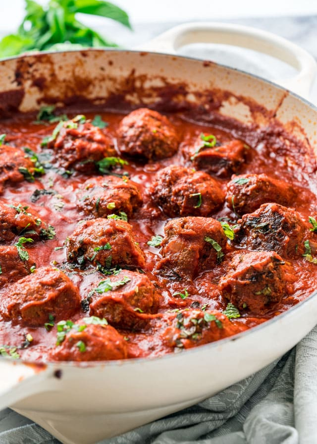 meatballs in tomato sauce topped with basil