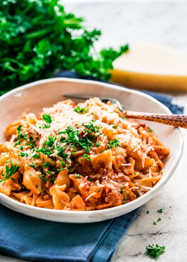 pasta alla vodka in a bowl topped with parmesan and parsley