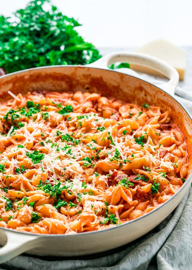 pasta alla vodka in a large pan topped with parmesan and parsley