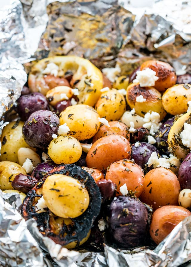 roasted potatoes with lemon slices and feta in foil