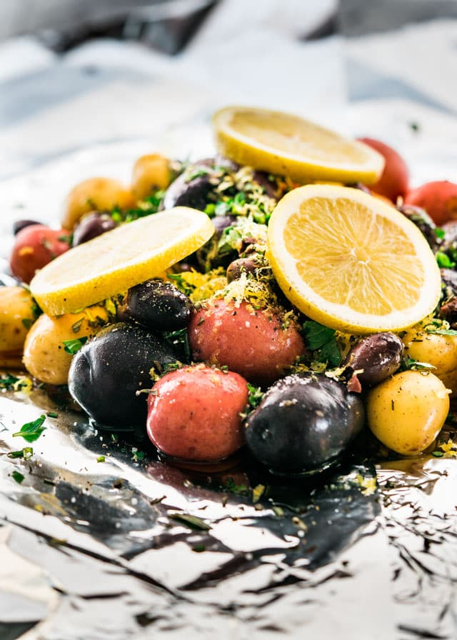 potatoes topped with herbs and lemon slices in foil