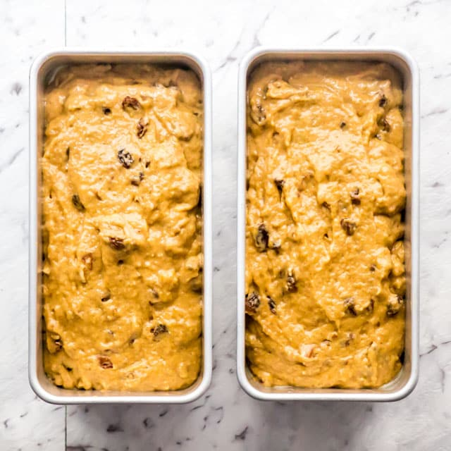 pumpkin cinnamon bread batter in 2 loaf pans