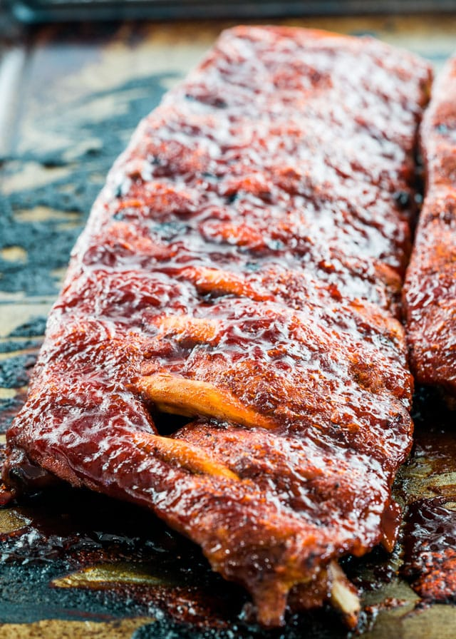 prok ribs falling off the bone covered in bbq sauce