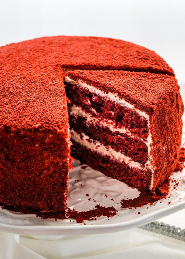 Red Velour Cake on a platter with a slice ready to serve