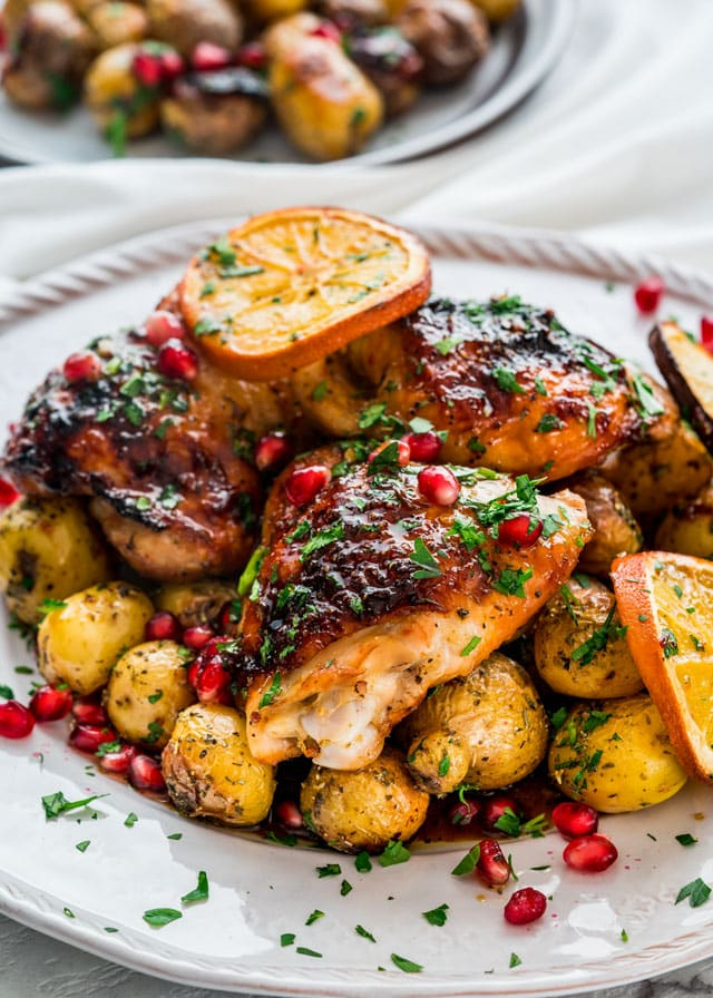 One Pan Roasted Honey Orange Chicken and Potatoes on a serving platter