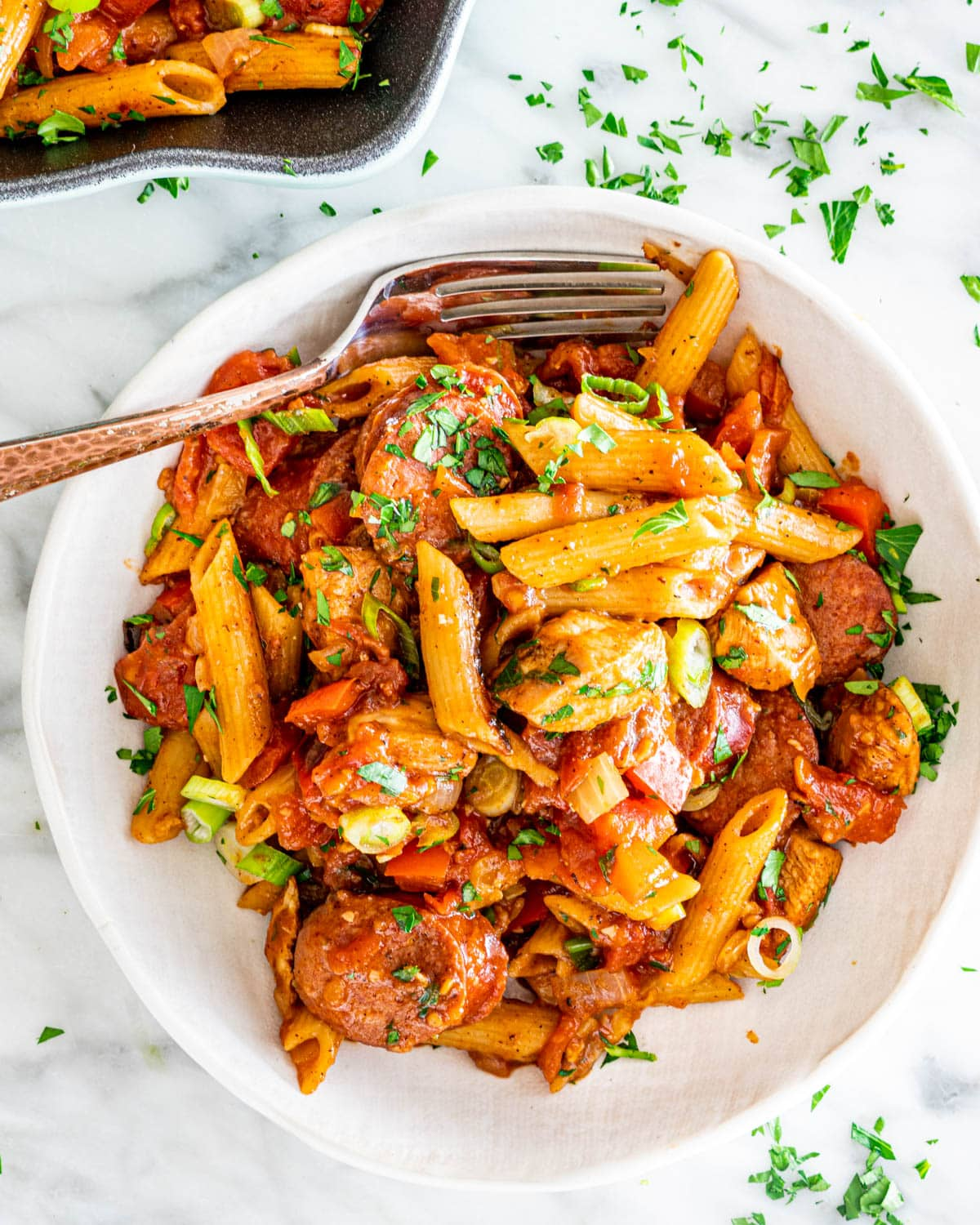 Chicken and Sausage Penne Jambalaya in a white plate