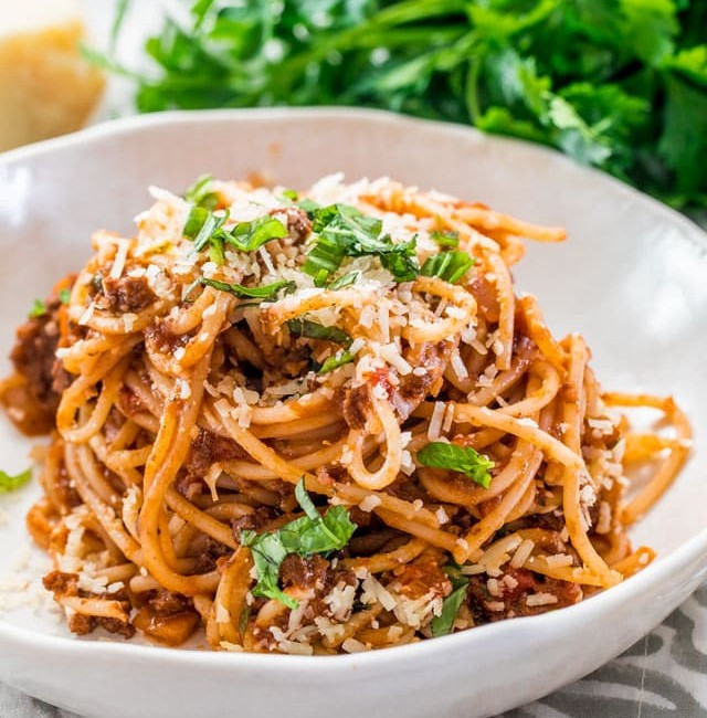 side view shot of a bowl with a scoop of spaghetti bolognese in it