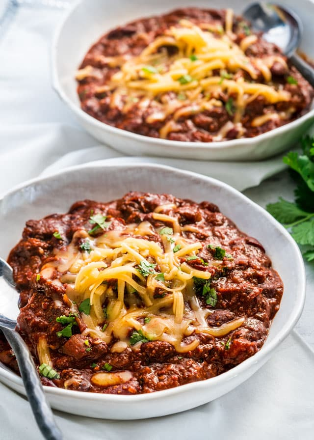 two bowl of chili and topped with cheese