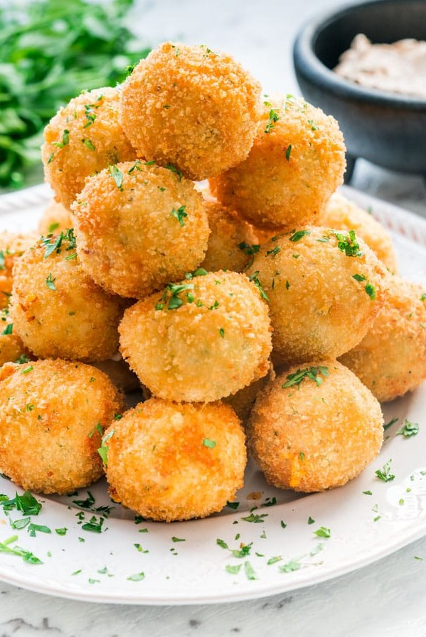 side view shot of a stack of potato croquettes on a plate