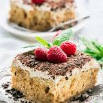 side view shot of a slice of tiramisu tres leches cake