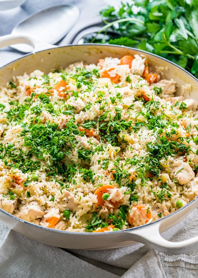 chicken rice pilaf in a large skillet garnished with parsley