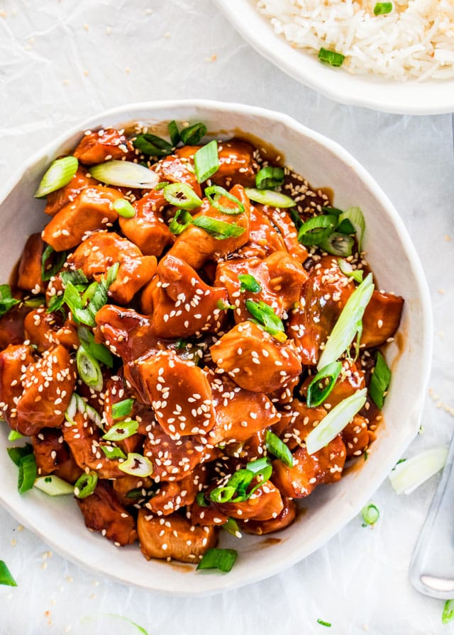 overhead shot of instant pot general tso's chicken in a white bowl