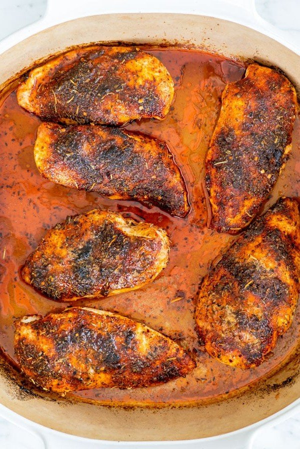 overhead shot of oven baked chicken breasts in a baking dish